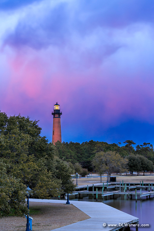 Currituck Beach Lighthouse captured at twilight from the top of the wooden bridge that connects the  Whale Head Club to the lighthouse.