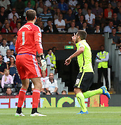 Sam Baldock scoring Brightons first goal past Marcus Bettinelli during the Sky Bet Championship match between Fulham and Brighton and Hove Albion at Craven Cottage, London, England on 15 August 2015. Photo by Matthew Redman.