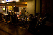 Tourists enjoy food and drink in outdoor restaurant tent on Florence, Italy.