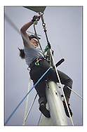 The Clipper Around the World Race 2000..Tracy changes the Halyards on the Spinnaker. . .Marc Turner / PFM.www.pfmpictures.co.uk
