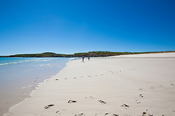 Tourists from charter boat MV Odyssey walk on a remote Kimberley island near Hanover Bay.