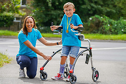 © Licensed to London News Pictures. 01/08/2020. Sheffield, UK. Tobias Weller aged 9,Sheffield, poses for a picture alongside Olympic athlete Jessica Ennis Hill aftercompletes the final 1.2km leg of his marathon in Sheffield, South Yorkshire. Nine-year-old Tobias Weller, from Sheffield, who has cerebral palsy and autism, has raised over £100,000 for Children Hospital Charity and Paces by walking a 26.2-mile marathon during the lockdown. Tobias Weller has been inspired by WWII veteran Captain Sir Thomas Moore to take his fundraising one step ahead.<br />  Photo credit: Ioannis Alexopoulos/LNP