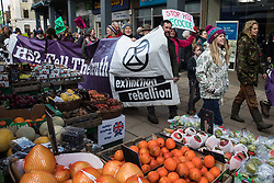 Uxbridge, UK. 1 February, 2020. Environmental activists from Stop HS2, Save the Colne Valley and Extinction Rebellion campaigning against the controversial HS2 high-speed rail link walk through Uxbridge town centre during a 'Still Standing for the Trees' march from the Harvil Road wildlife protection camp in Harefield through Denham Country Park to three addresses closely linked to Boris Johnson in his Uxbridge constituency. The Prime Minister is expected to make a decision imminently as to whether to proceed with the high-speed rail line.