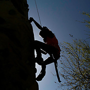 March 7, 2015, Indian Wells, California:<br /> A girl climbs a rock climbing wall during Kids Day at the Indian Wells Tennis Garden in Indian Wells, California Saturday, March 7, 2015.<br /> (Photo by Billie Weiss/BNP Paribas Open)