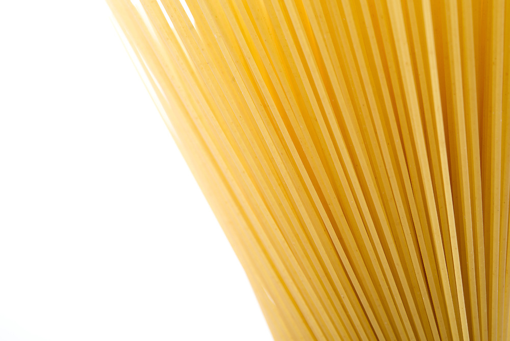 Spaghetti spread out on white background