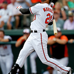 March 20, 2012; Sarasota, FL, USA; Baltimore Orioles right fielder Nick Markakis (21) hits a fly out during the bottom of the first inning of a spring training game against the Philadelphia Phillies at Ed Smith Stadium.  Mandatory Credit: Derick E. Hingle-US PRESSWIRE