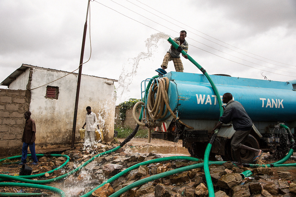 Loading municipal water trucks straight from the Nile riverbanks. Some loads would be treated, some are purchased and consumed as untreated drinking water. In the Kator neighborhood of Juba, South Sudan.