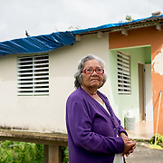 NOVEMBER 17, 2017&ndash;MARICAO, PUERTO RICO&mdash;<br /> Felicita Dragones, 76, stands outside her Hurricane Maria damaged house in the mountain town of Maricao. Dragons lives alone in the house which lost parts of its roof and is now covered with a blue tarp.<br /> (Photo by Angel Valentin)