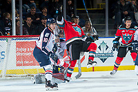 KELOWNA, CANADA - OCTOBER 27: Dylan Coghlan #10 watches the puck as Patrick Dea #30 of the Tri-City Americans moves Leif Mattson #28 of the Kelowna Rockets from the line of sight during first period on October 27, 2017 at Prospera Place in Kelowna, British Columbia, Canada.  (Photo by Marissa Baecker/Shoot the Breeze)  *** Local Caption ***