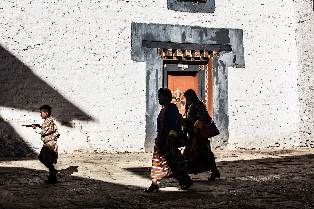 A family on their way top a festival in Trongsa, Bhutan