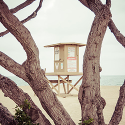 Newport Beach Wedge Lifeguard Tower W through trees. The Wedge is a popular spot for surfers on Balboa Peninsula in Orange County Southern California. Photo Copyright ⓒ 2010 Paul Velgos with All Rights Reserved.