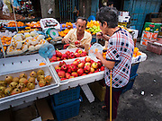 07 OCTOBER 2014 - GEORGE TOWN, PENANG, MALAYSIA: A fruit vendor in a market in George Town (also Georgetown), the capital of the state of Penang in Malaysia. Named after Britain's King George III, George Town is located on the north-east corner of Penang Island. The inner city has a population of 720,202 and the metropolitan area known as George Town Conurbation which consists of Penang Island, Seberang Prai, Kulim and Sungai Petani has a combined population of 2,292,394, making it the second largest metropolitan area in Malaysia. The inner city of George Town is a UNESCO World Heritage Site and one of the most popular international tourist destinations in Malaysia.         PHOTO BY JACK KURTZ