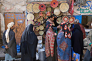 A vendor of kitchen wares attends to customers in the old souk market in Sanaa, Yemen.
