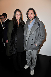 MARC NEWSON and his wife CHARLOTTE STOCKDALE at a private view of 'Engagement' an exhibition of new works by Jennifer Rubell held at the Stephen Friedman Gallery, 25-28 Old Burlington Street, London on 7th February 2011.