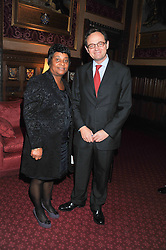 DOREEN LAWRENCE and WILL LAWES at a reception for the Stephen Lawrence Charitable Trust hosted by the Speaker of The House of Commons John Bercow and supported by law firm Freshfields Bruckhaus Deringer in The State Rooms, Speaker's House, the House of Commons, London on 19th December 2012.