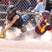 Brampton's second baseman Melissa McKnight scores Brampton's first run in preliminary action against Surrey BC on Friday. Surrey's catcher Calli Birch makes the catch.