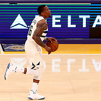 30 March 2018: Milwaukee Bucks guard Eric Bledsoe (6) brings the ball up court during the Milwaukee Bucks 124-122 victory over the LA Lakers, at the Staples Center, Los Angeles, California, USA.