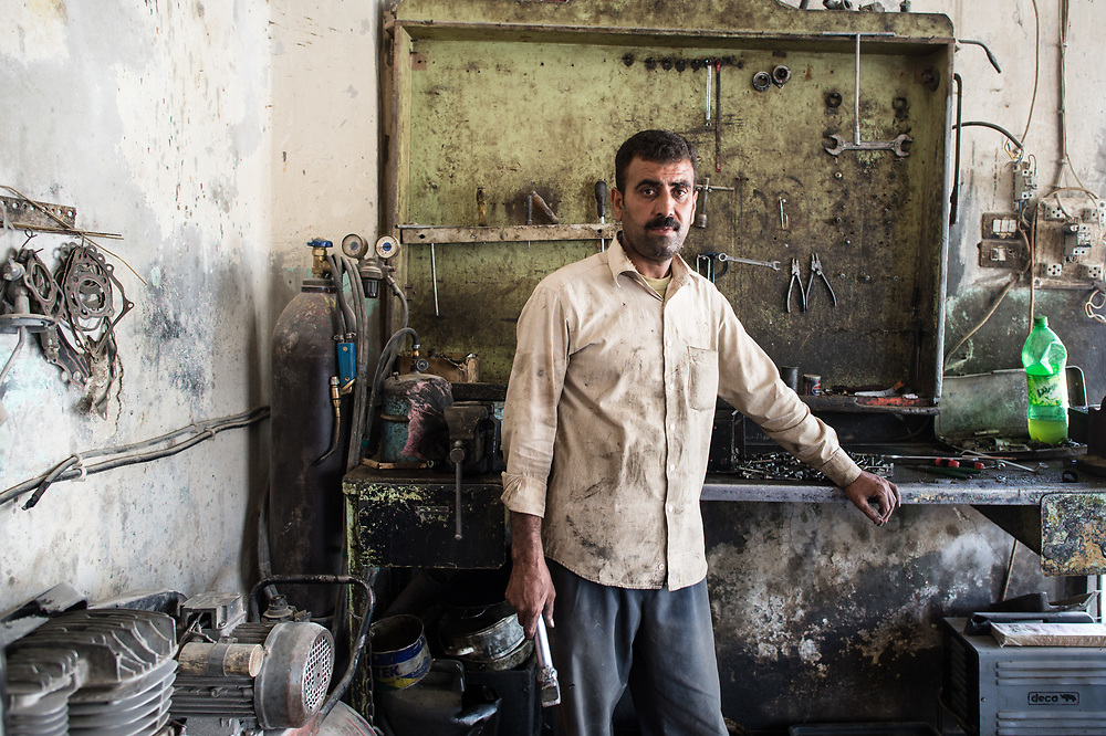 Zilim Mahamad found his car repair shop plundered and his house destroyed when he returned to Kobanê. Because the Turkish border is closed, it is difficult to get things he would need for his shop, tells the 43-year-old. Kobanê (Ayn al-Arab), Syria, June 21, 2015