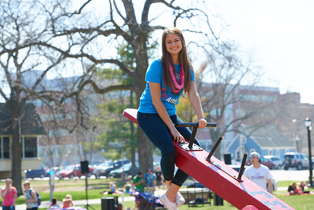 Activity; Socializing; Playing; Buildings; Eagle Hall; Location; Outside; People; Student Students; Spring; April; Time/Weather; sunny; Type of Photography; Candid; UWL UW-L UW-La Crosse University of Wisconsin-La Crosse; Woman Women; Teeter totter