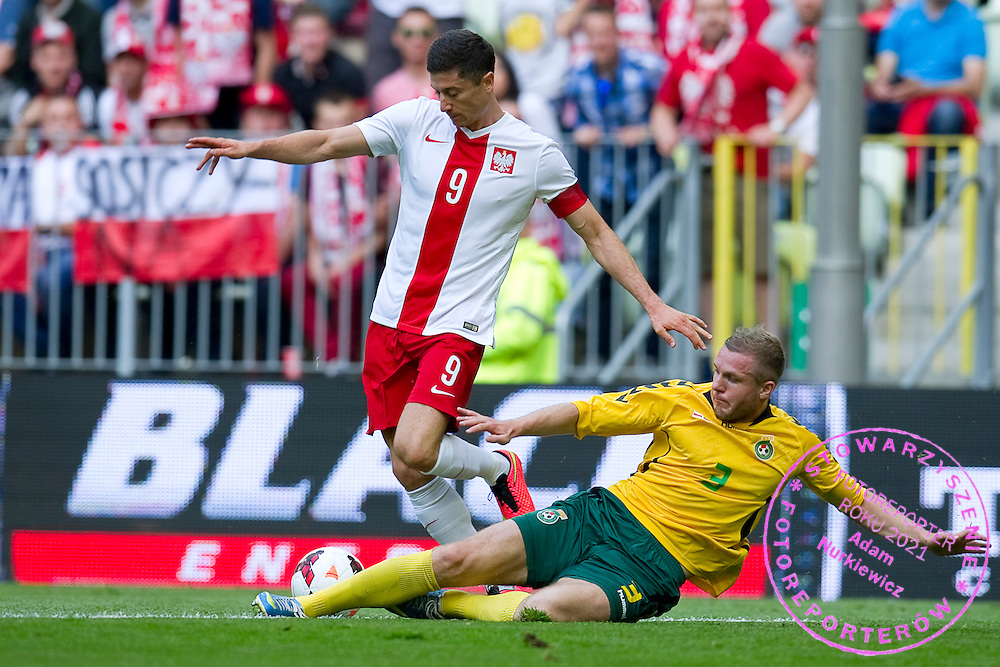 (L) Poland's Robert Lewandowski fights for the ball with (R) Georgas Freidgeimas from Lithuania during international friendly match between Poland and Lithuania at PGE Arena in Gdansk, Poland.<br /> <br /> Poland, Gdansk, June 06, 2014<br /> <br /> Picture also available in RAW (NEF) or TIFF format on special request.<br /> <br /> For editorial use only. Any commercial or promotional use requires permission.<br /> <br /> Mandatory credit:<br /> Photo by &copy; Adam Nurkiewicz / Mediasport
