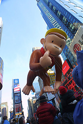 A Curious George balloon takes part in the 75th Macy's Thanksgiving Day Parade passing through Times Square, November 2001.