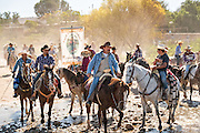 Mexican cowboys ride across a stream to water their horses on their way to join the annual Cabalgata de Cristo Rey cowboy pilgrimage January 4, 2017 in Guanajuato, Mexico. Thousands of Mexican cowboys and horse come from all over to take part in the three-day ride to the mountaintop shrine of Cristo Rey.