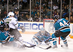 December 11, 2009; San Jose, CA, USA; San Jose Sharks goalie Evgeni Nabokov (20) makes a save from Dallas Stars center Toby Petersen (17) during the first period at HP Pavilion. Dallas defeated San Jose 3-2 in the 11th round of a shootout. Mandatory Credit: Jason O. Watson / US PRESSWIRE