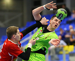 12.04.2014, BSFZ Suedstadt, Maria Enzersdorf, AUT, HLA, SG INSIGNIS Handball WESTWIEN vs Moser Medikal UHK Krems, im Bild Gerdas Babarskas, (Moser Medikal UHK Krems, #3) und Alexander Hermann, (SG INSIGNIS Handball WESTWIEN, #2) , EXPA Pictures © 2014, PhotoCredit: EXPA/ T. Haumer