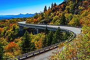 Autumn colors surround the Linn Cove Viaduct on the Blue Ridge Mountain Parkway in North Carolina, <br /> <br /> &copy; Photography by Kathy Kmonicek