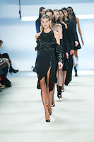 Kate Grigorieva walks the runway wearing Cushnie et Ochs Fall 2016, hair by Antonio Corral Calero for Moroccanoil, makeup by Val Garland, photographed by Thomas Concordia during New York Fashion Week on February 12, 2016