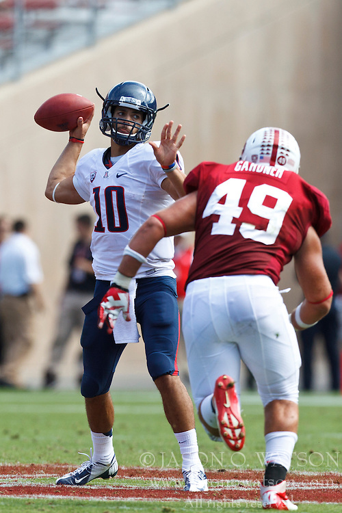 PALO ALTO, CA - OCTOBER 06: Quarterback Matt Scott #10 of the Arizona Wildcats is pressured by defensive end Ben Gardner #49 of the Stanford Cardinal during the second quarter at Stanford Stadium on October 6, 2012 in Palo Alto, California. The Stanford Cardinal defeated the Arizona Wildcats 54-48 in overtime. (Photo by Jason O. Watson/Getty Images) *** Local Caption *** Matt Scott; Ben Gardner