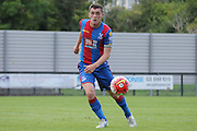 Connor Dymond playing a ball out to the wing during the U21 Professional Development League match between Crystal Palace U21s and Huddersfield U21s at Imperial Fields, Tooting, United Kingdom on 7 September 2015. Photo by Michael Hulf.