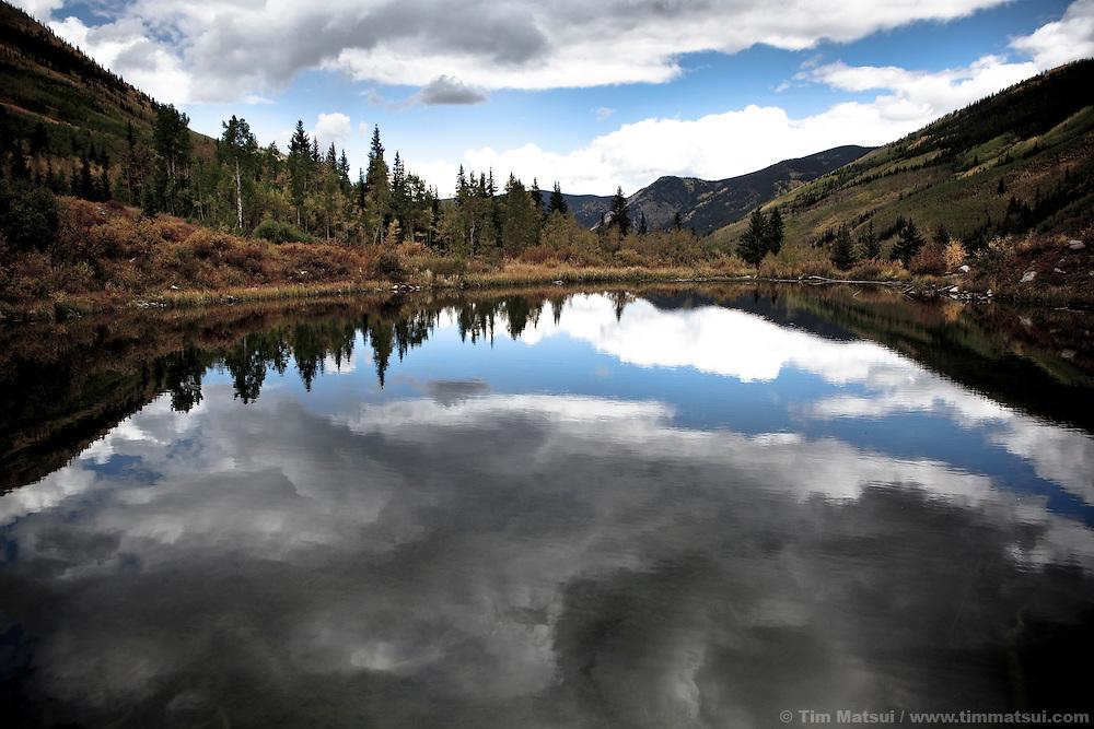 Reflection of an alpine landscape in a mountain lake near Aspen, Colorado