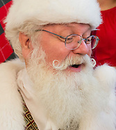 Nov. 21, 2012 - Garden City, New York, U.S. - Santa Claus already is getting Christmas holiday visits from children at Roosevelt Field shopping mall in Long Island. Roosevelt Field, one of the 10 largest shopping malls in the United States of America, is on the site where aviator Charles Lindbergh began his historic solo transatlantic flight to Paris in 1927.