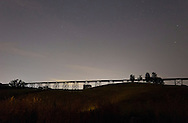 Salisbury Mills, New York -Stars and light pollution over the Moodna Viaduct railroad trestle on July 8, 2012.