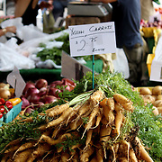 Fresh organic yellow carrots background, photo taken at local farmers market, in New York City