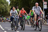 Family groups on The Victoria Embankment. The Prudential RideLondon FreeCycle. Saturday 28th July 2018<br /> <br /> Photo: Ian Walton for Prudential RideLondon<br /> <br /> Prudential RideLondon is the world's greatest festival of cycling, involving 100,000+ cyclists - from Olympic champions to a free family fun ride - riding in events over closed roads in London and Surrey over the weekend of 28th and 29th July 2018<br /> <br /> See www.PrudentialRideLondon.co.uk for more.<br /> <br /> For further information: media@londonmarathonevents.co.uk