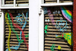 © Licensed to London News Pictures. 13/04/2020. London, UK. Hand painted drawings are seen in a window of a house in north London in support of NHS. Coronavirus lockdown continues to slow the spread of COVID-19 and reduce pressure on the NHS. Photo credit: Dinendra Haria/LNP