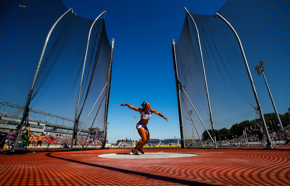 Yaime Perez of Cuba competes on her way to winning the silver medal in the women's discus throw during the athletics at the Pan Am Games in Toronto, Friday July 24, 2015.    THE CANADIAN PRESS/Mark Blinch