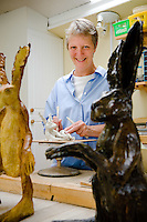 Ceramic artist Denise Hayhurst working in her studio in Kilham village