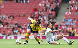 Emma Mitchell of Arsenal shrugs off a challenge from Jovana Damnjanovic of Bayern Munich - Mandatory by-line: Arron Gent/JMP - 28/07/2019 - FOOTBALL - Emirates Stadium - London, England - Arsenal Women v Bayern Munich Women - Emirates Cup