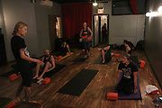 NEW YORK CITY, NEW YORK, MARCH 30, 2016. Caryn Havlik listens to Metal Bones Yoga instructor Saskia Thode. The class takes place at 6:30 p.m. on Wednesdays at The Cobra Club in Bushwick, Brooklyn. 03/30/2016. Photo by Donna M. Airoldi/NYC News Service