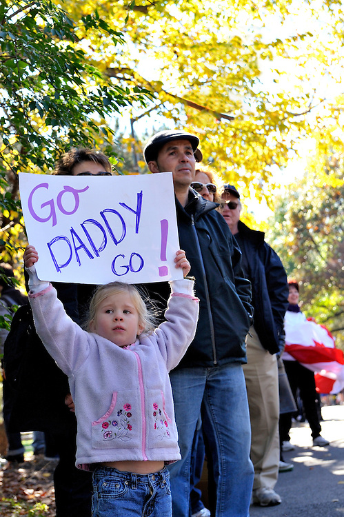 """New York, NY November 7: Little girl age 4-6 holds sign """"Go Daddy Go"""" cheering on her father New York City Marathon 2010. EDITORIAL USE ONLY."""