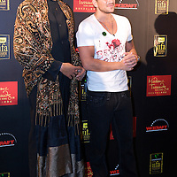 MACAU, CHINA - JUNE 11:  Singer Peter Andre poses with a wax figure of Bollywood icon and IIFA Ambassador Amitabh Bachchan at the green carpet during the 2009 International Indian Film Academy Awards at the Venetian Macao-Hotel-Resort on June 11, 2009 in Macau.  Photo by Victor Fraile / studioEAST