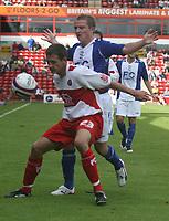 Photo: Mark Stephenson.<br /> Walsall v Birmingham City. Pre Season Friendly. 28/07/2007.Walsall's nes signing Paul Boertien holds up Birmingham's Gary McSheffery