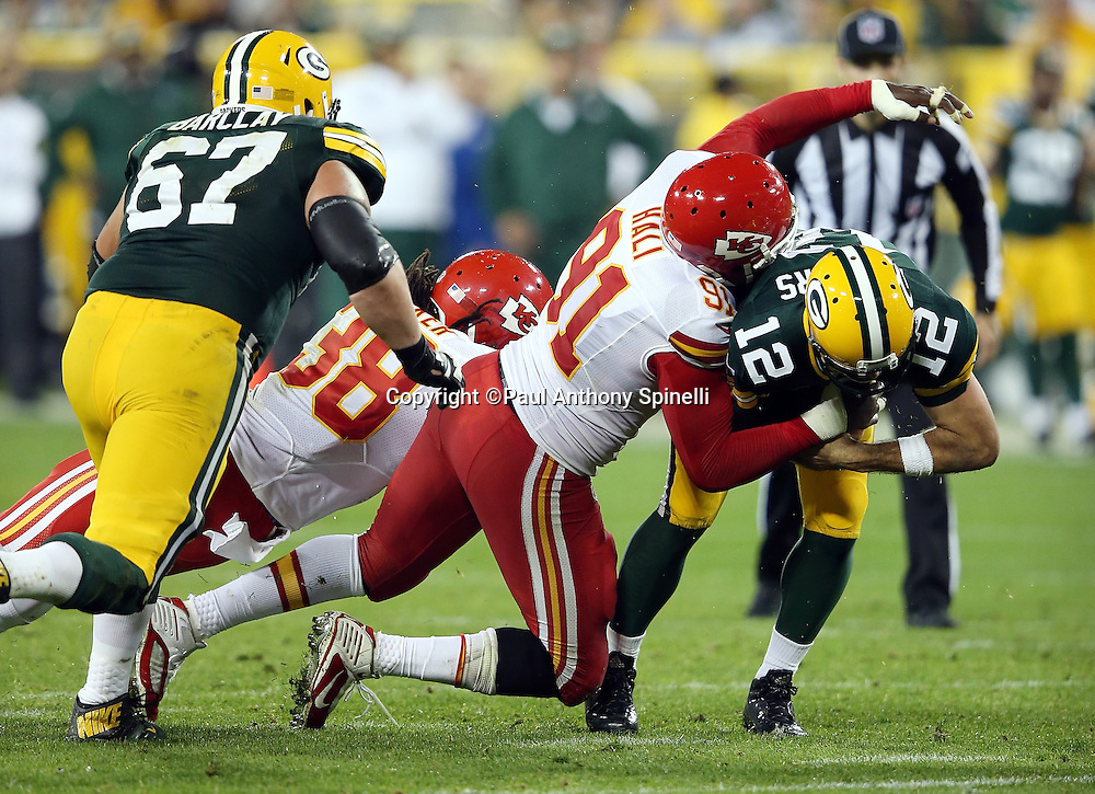 Kansas City Chiefs outside linebacker Tamba Hali (91) sacks Green Bay Packers quarterback Aaron Rodgers (12) for a loss of 8 yards and forcing a field goal attempt on this second quarter play during the 2015 NFL week 3 regular season football game against the Green Bay Packers on Monday, Sept. 28, 2015 in Green Bay, Wis. The Packers won the game 38-28. (©Paul Anthony Spinelli)