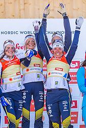 28.02.2019, Seefeld, AUT, FIS Weltmeisterschaften Ski Nordisch, Seefeld 2019, Langlauf, Damen, Staffel 4x5 km, Flower Zeremonie, im Bild Weltmeisterin und Goldmedaillengewinnerin Weltmeisterin und Goldmedaillengewinnerin Ebba Andersson (SWE), Frida Karlsson (SWE), Charlotte Kalla (SWE), Stina Nilsson (SWE) // World champion and Gold medalist World champion and Gold medalist Ebba Andersson Frida Karlsson Charlotte Kalla Stina Nilsson of Sweden during the flowers ceremony for the ladie's Relay 4x5 km competition of the FIS Nordic Ski World Championships 2019. Seefeld, Austria on 2019/02/28. EXPA Pictures © 2019, PhotoCredit: EXPA/ Stefan Adelsberger