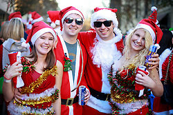 13 December 2014. New Orleans, Louisiana. <br /> Samantha Gould, David Burford, Blake Irizarry and Mara Hahn at the 4th annual running of the Santas in downtown New Orleans. Proceeds from the event benefit 'That Others May Love' charity.<br /> Photo; Charlie Varley/varleypix.com