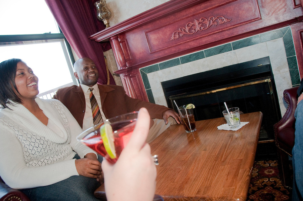 Friends enjoy a drink in the Northstar Lounge of The Landmark Inn an historic hotel in Marquette Michigan.