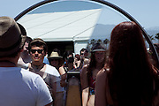 Fans experience a spinning mirror at the 2010 Coachella Music Festival in Indio, CA on April 16, 2010.